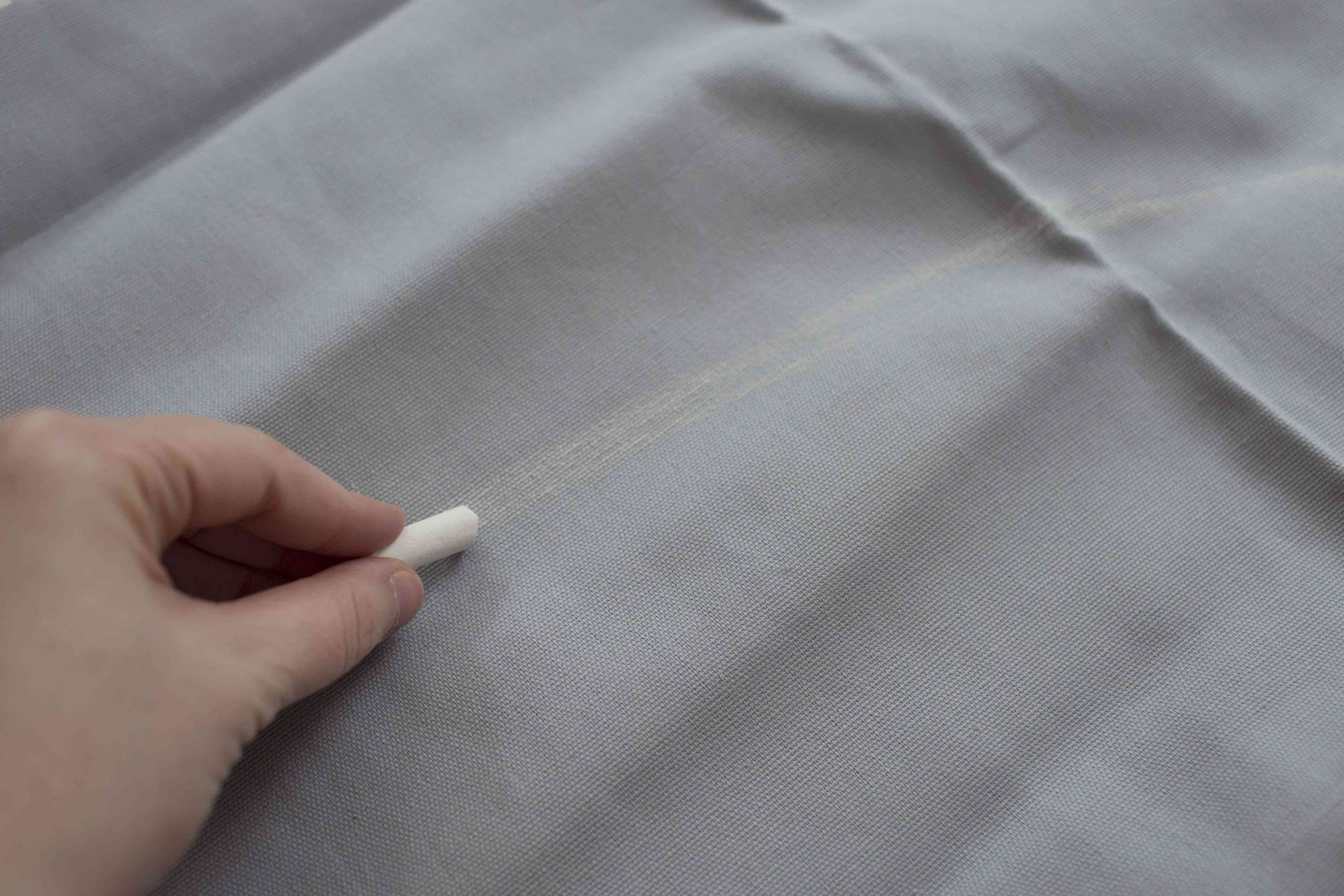 using chalk to measure fabric