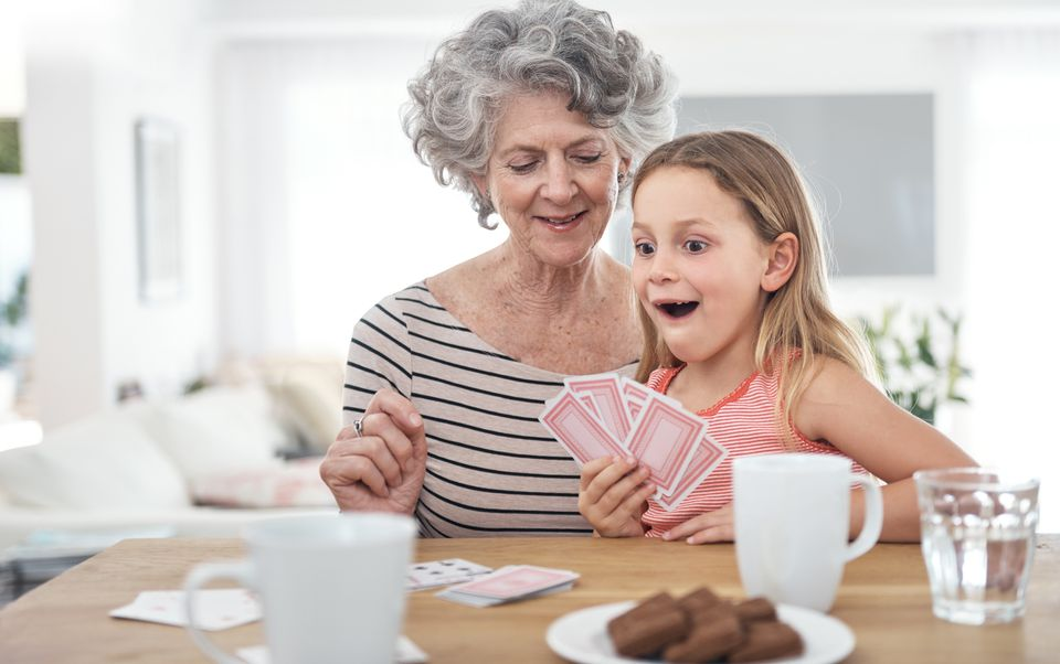 Child and grandmother playing cards