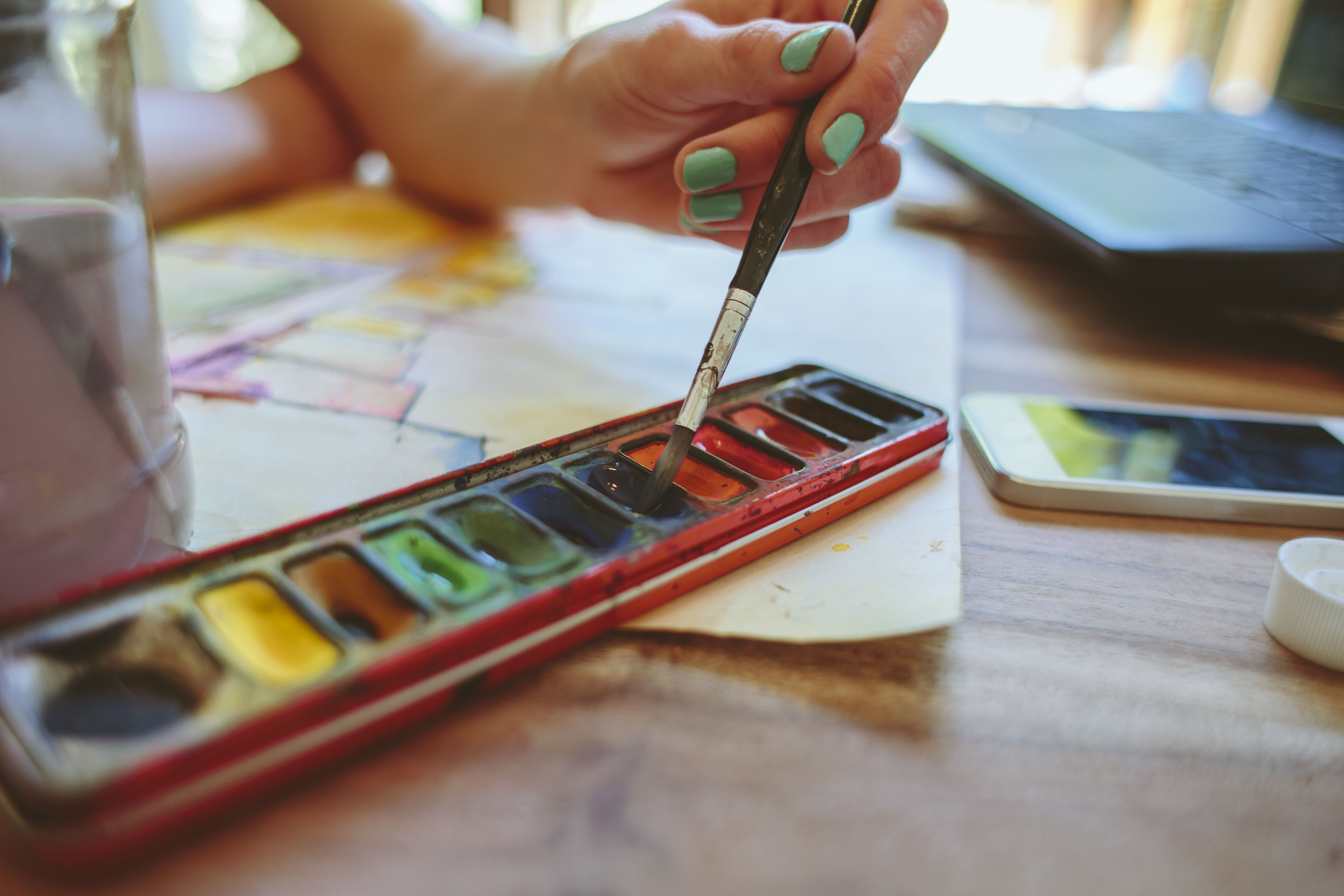 An artist painting with watercolours