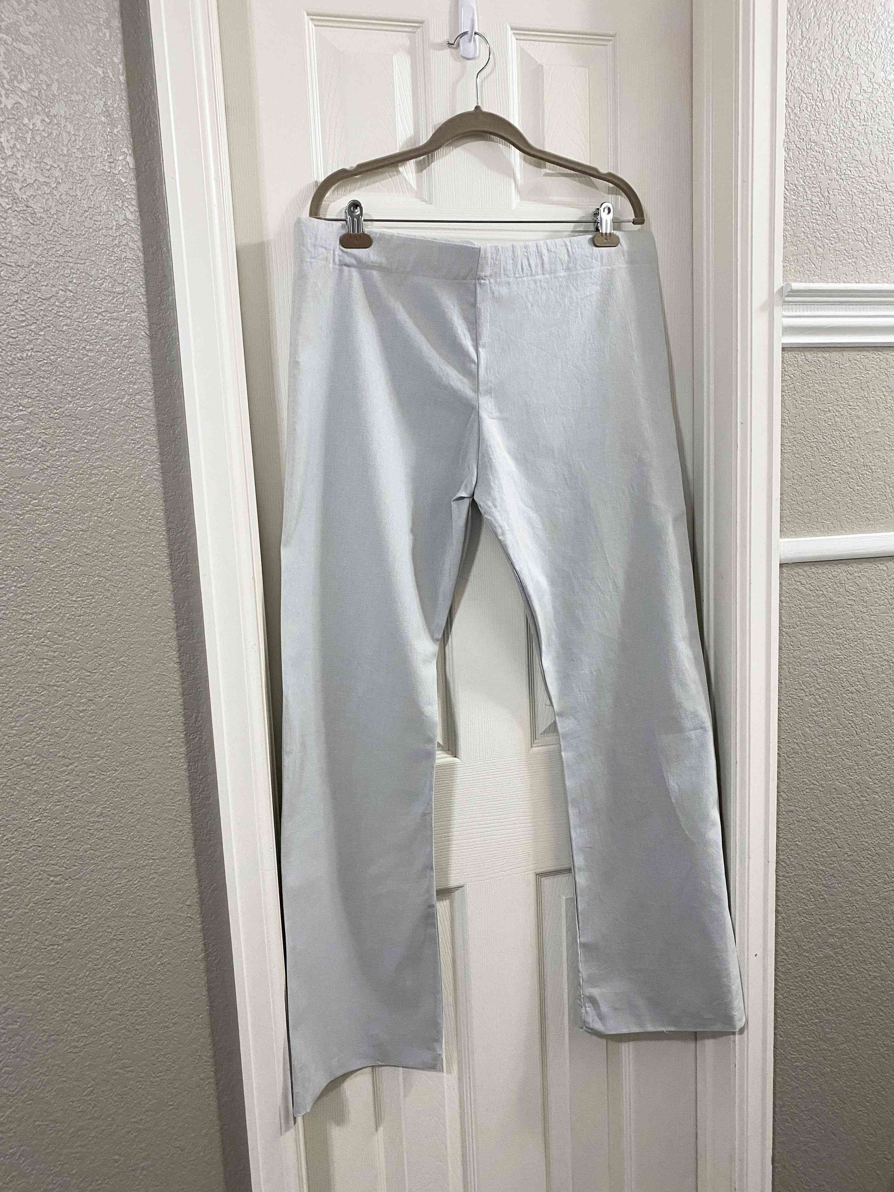 A pair of pants hanging on a door