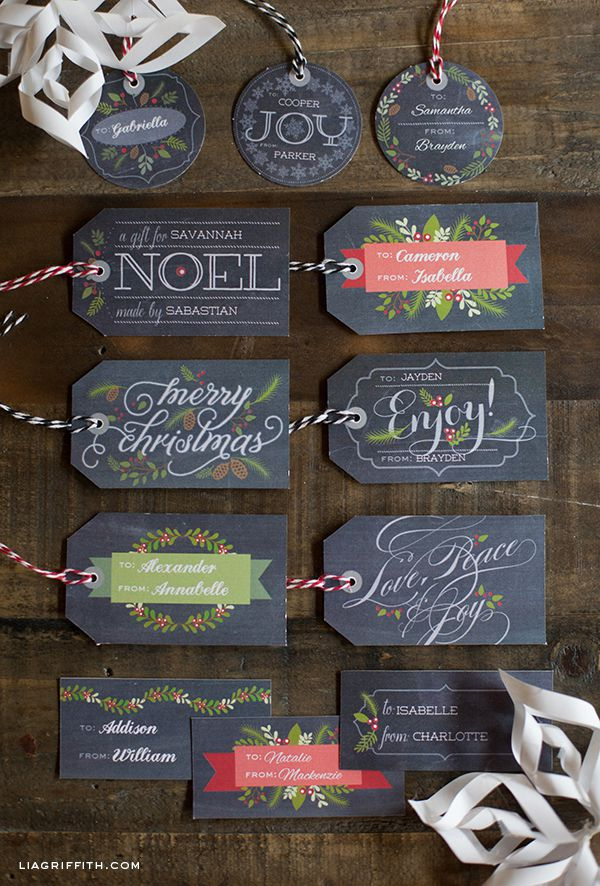 Chalkboard style Christmas gift tags laying on a table.