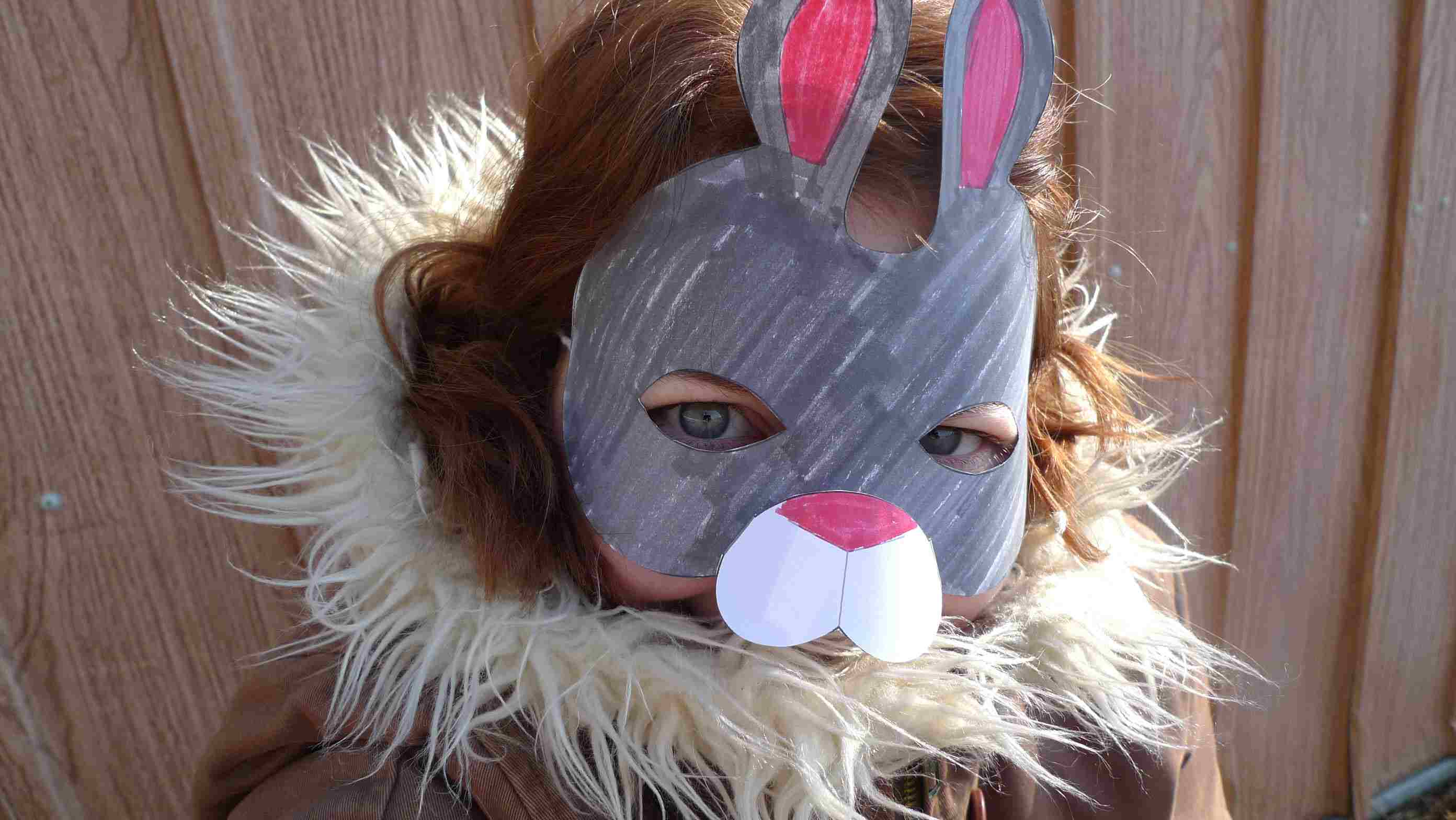 A girl wearing a printable Easter mask.