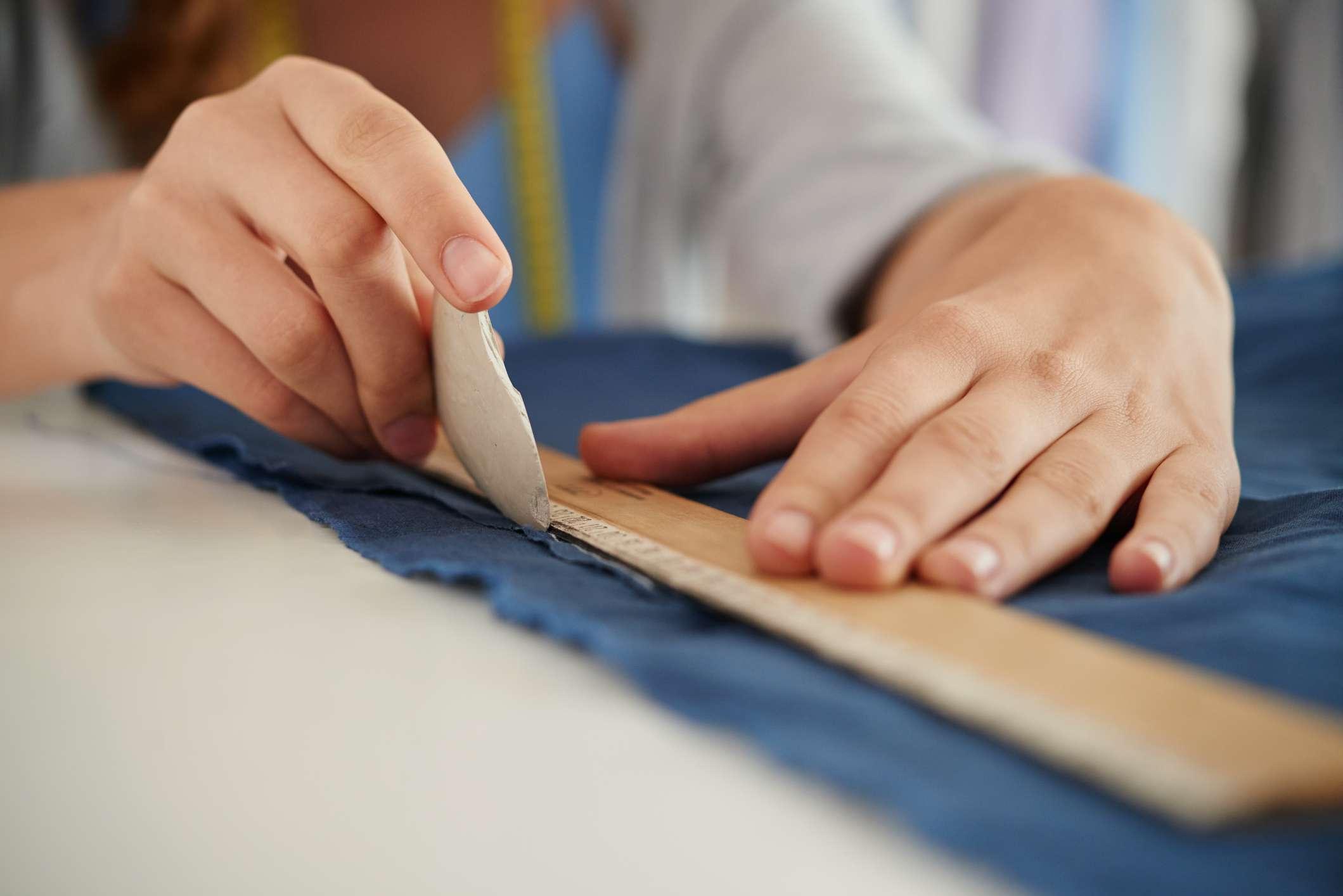 Designer using tailor chalk