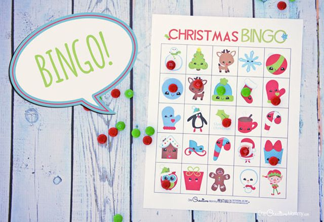 A Christmas bingo card and pieces on a table.
