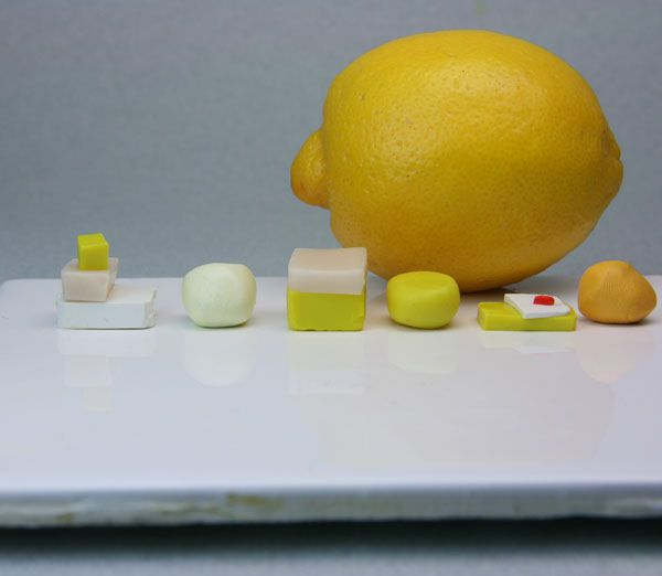 Polymer clay colors used to make lemon pith, sections and skin for dollhouse scale lemon canes.