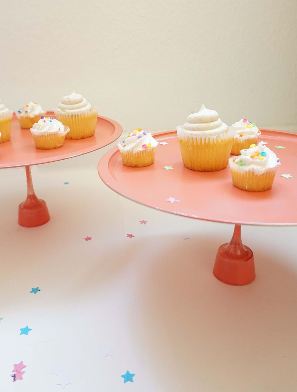 Pink DIY cupcake stand with vanilla cupcakes and confetti.