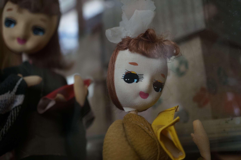 Antique Dolls Seen Through Glass Window