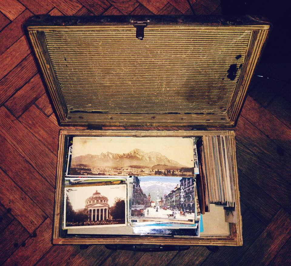 Postcards in Suitcase on Table