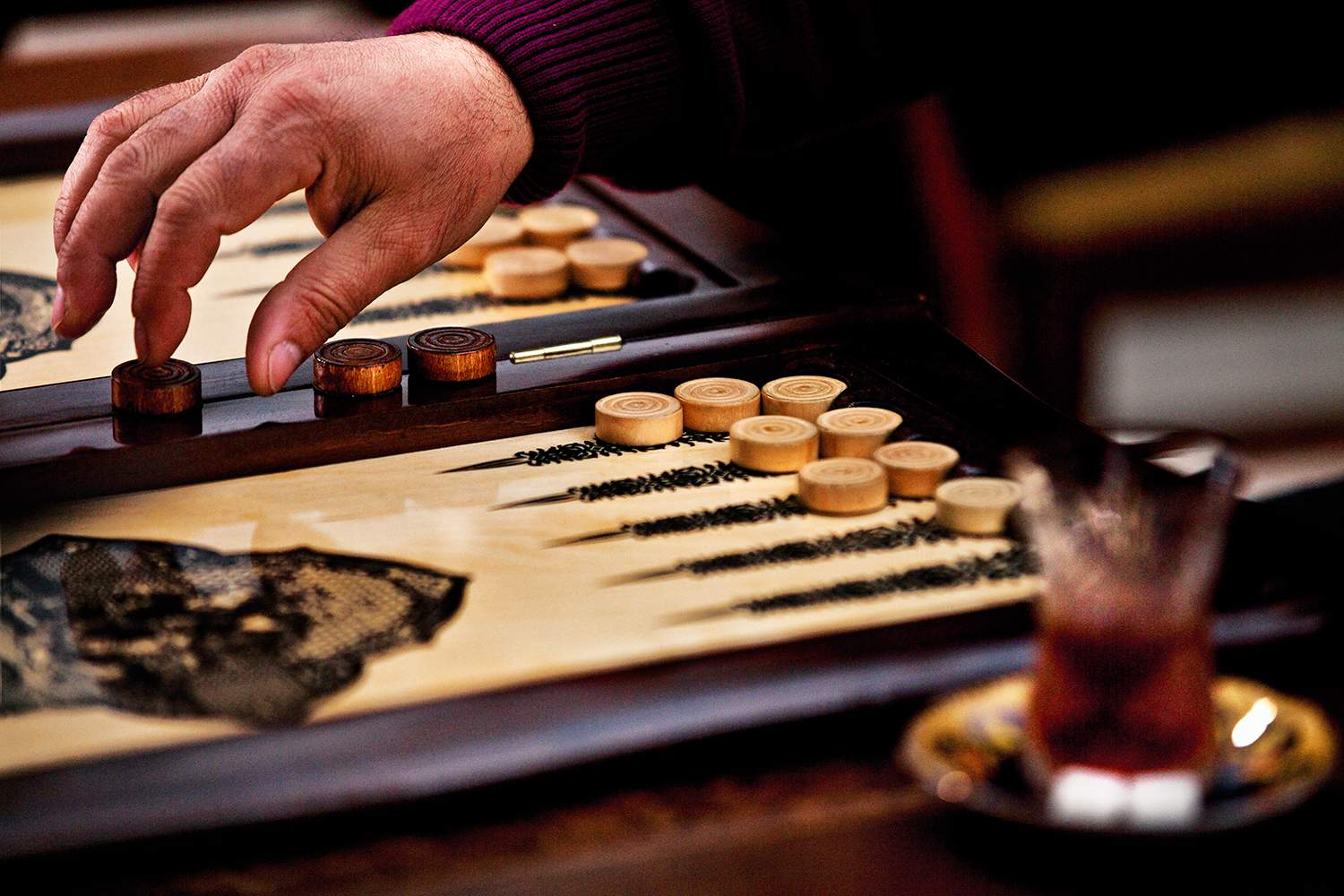 Man playing Backgammon.