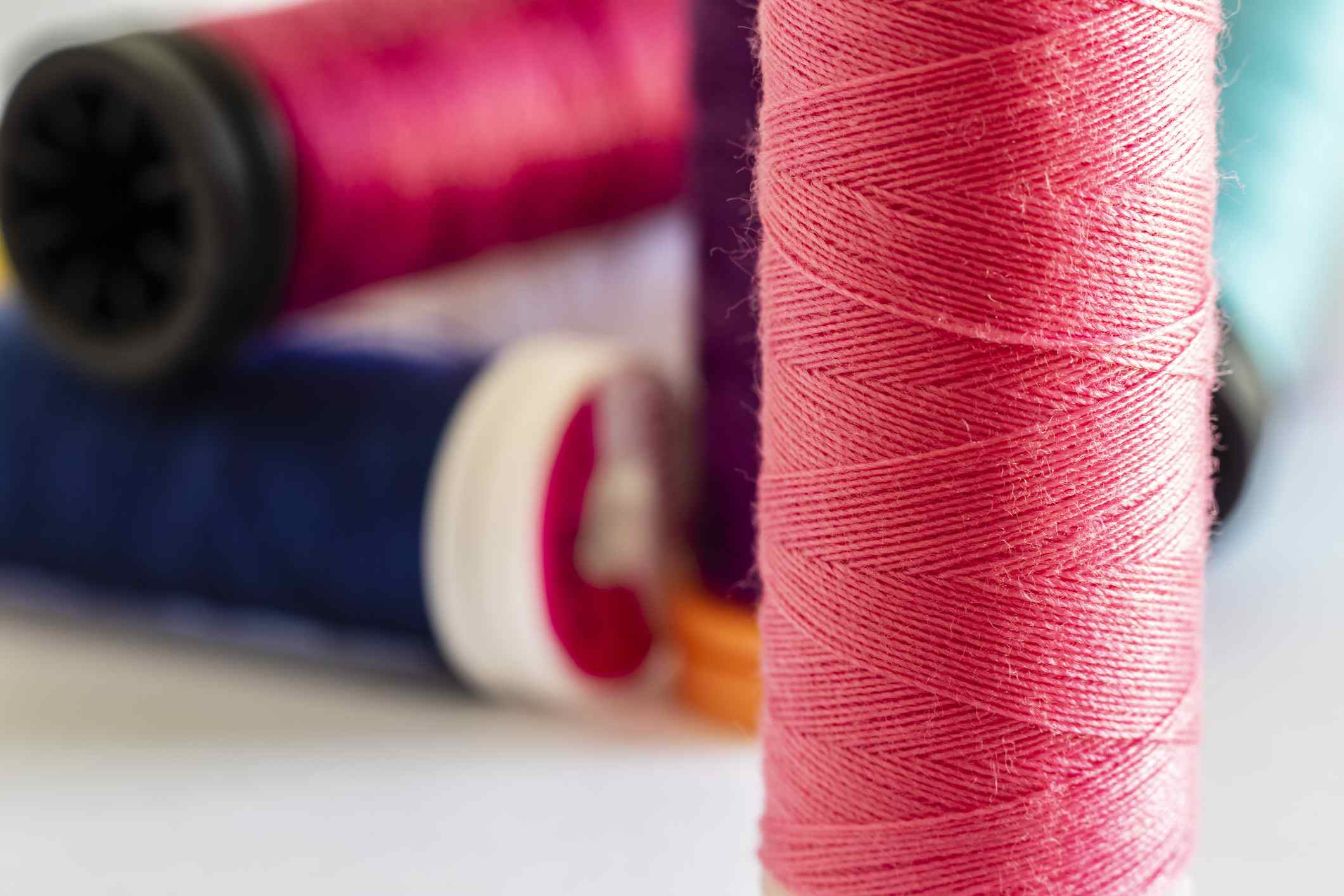 close-up on sewing thread spools