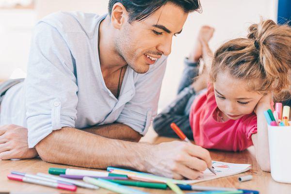 Father and daughter coloring pages together