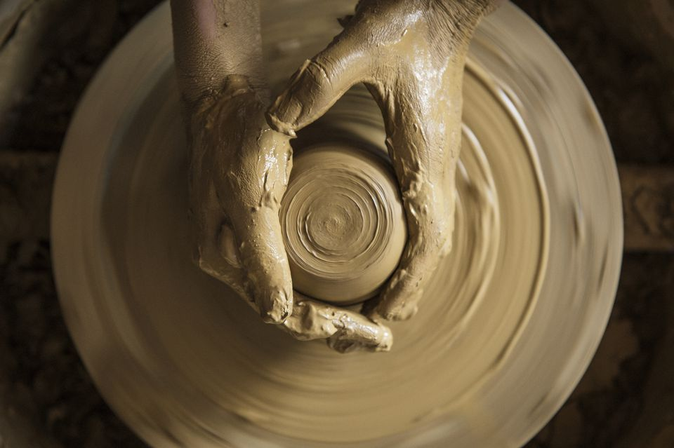 A woman using a potter's wheel in pottery
