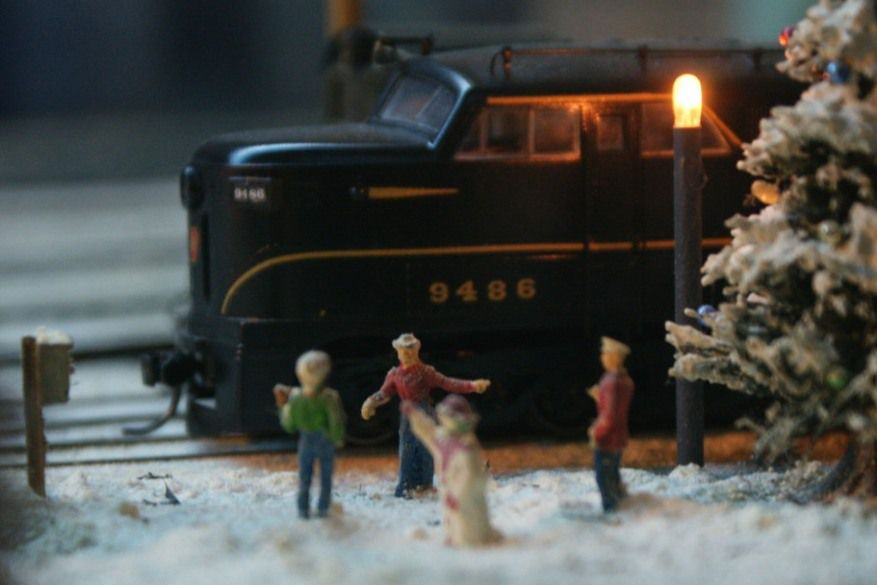 A set of model people with a model train