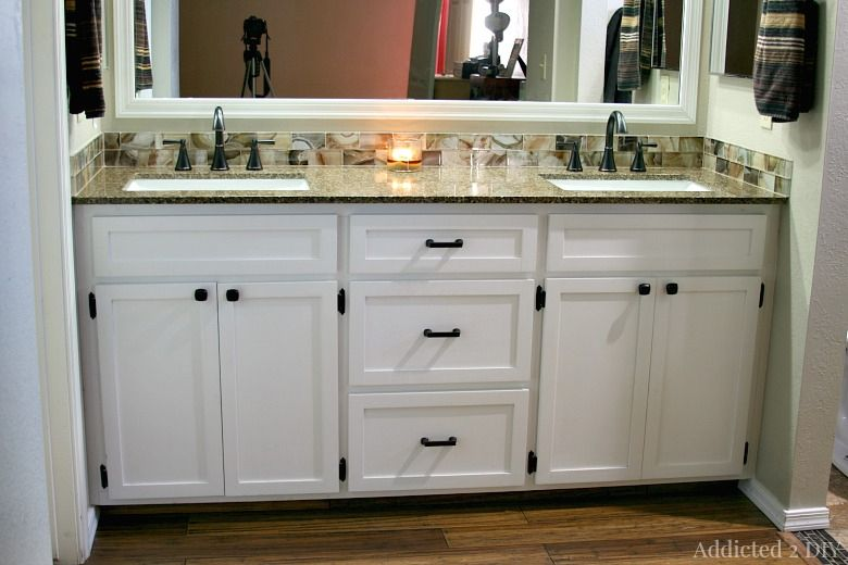 A white DIY bathroom vanity installed in a bathroom
