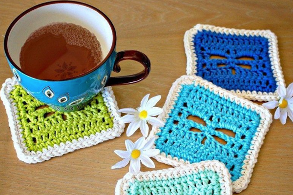 tea in a mug on crocheted coasters