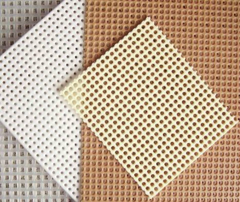 Plastic cross stitch surfaces