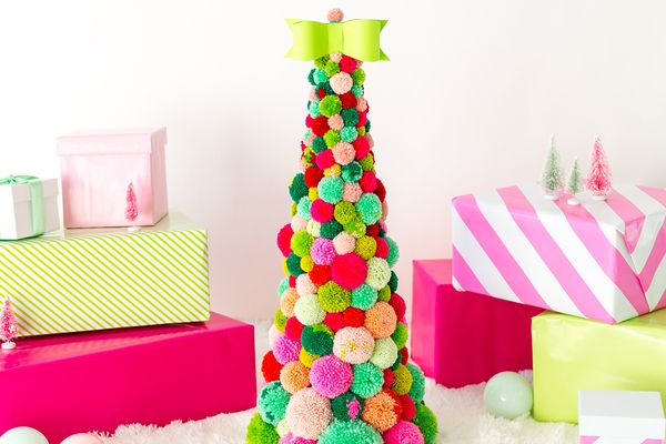A Christmas tree made from colorful pom poms.