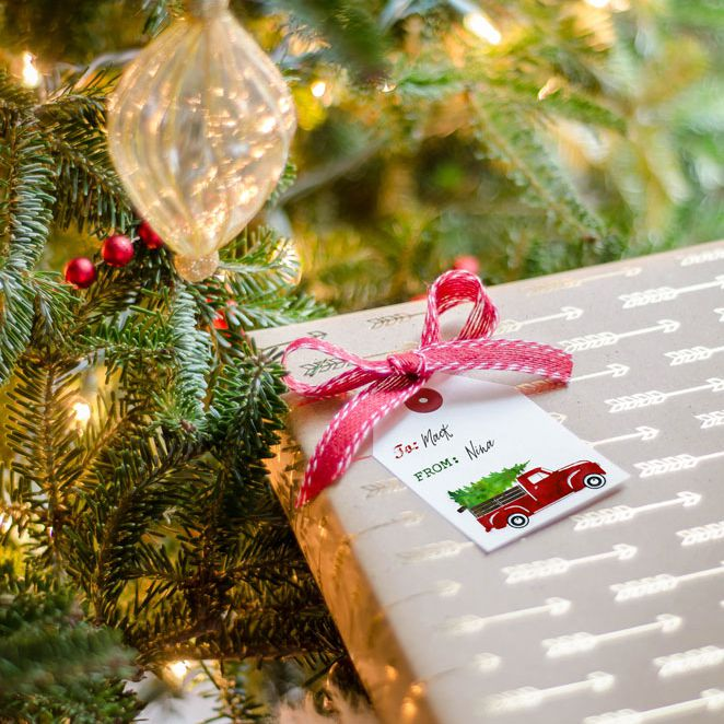 a vintage truck christmas gift tag on a present
