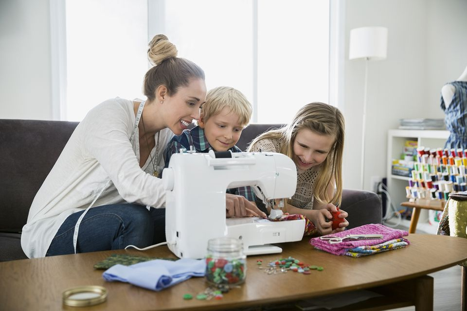 Mother and Children Sewing at Sewing Machine