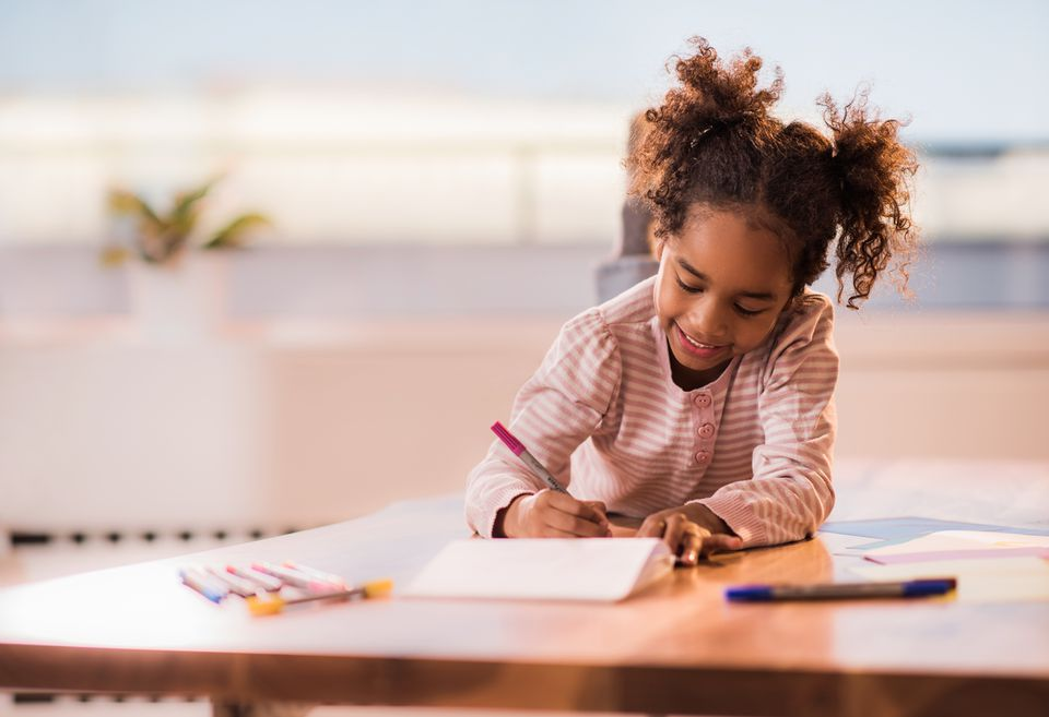 Young girl working in notebook