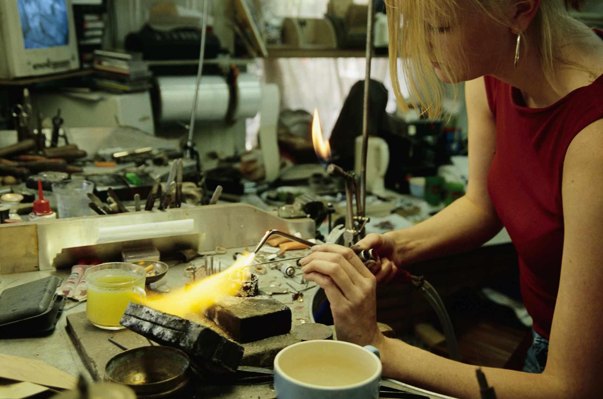 Woman Soldering Jewelry