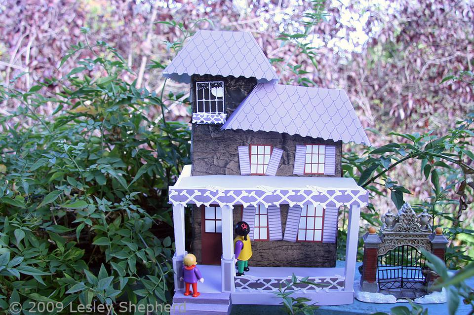 1:24 scale haunted house made from a recycled cereal box, a paper bag and free printables.