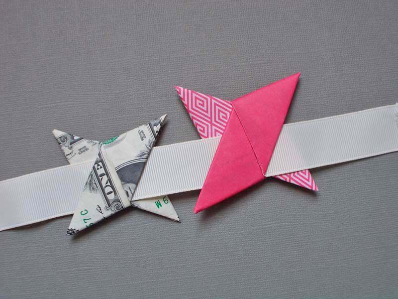 An origami ninja star garland made of dollar bills and paper