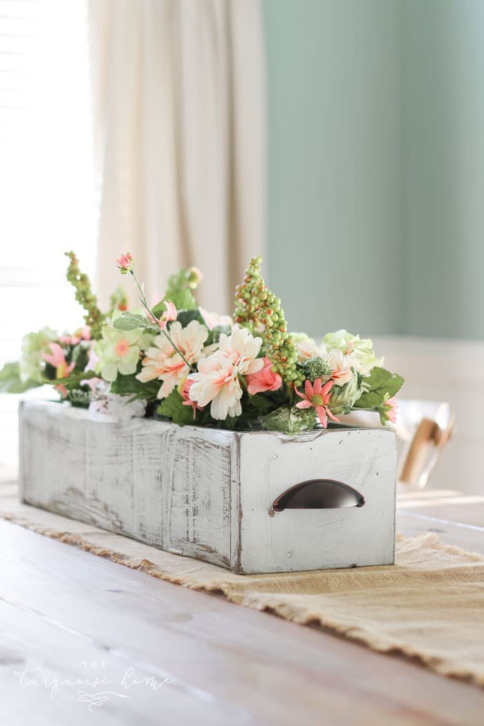 diy flower arrangement inside wood drawer
