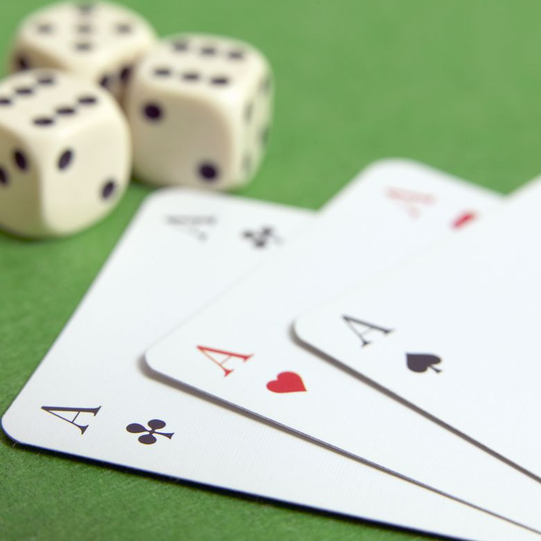 Dice and three aces, close-up
