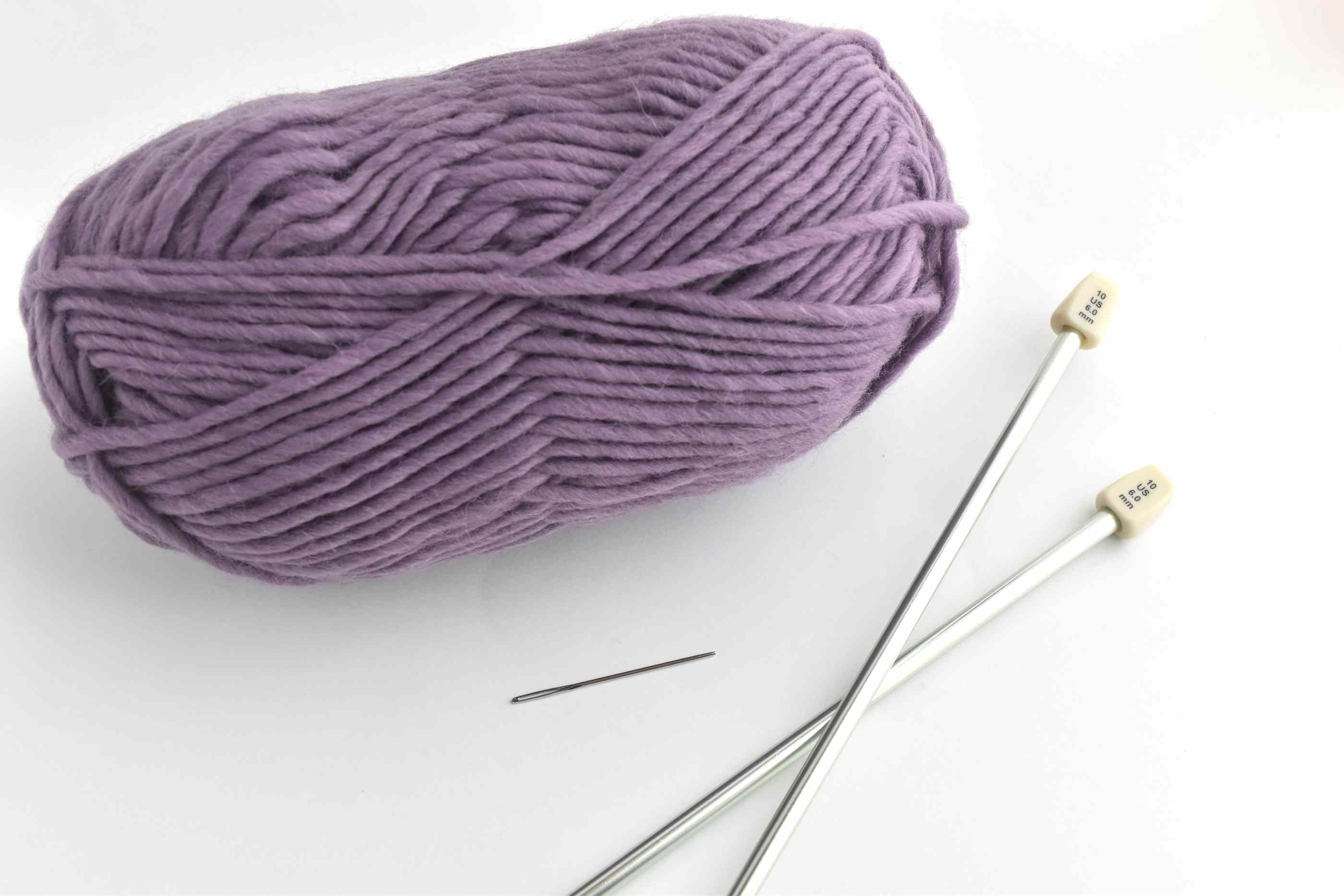 Yarn Skein, Knitting Needles, and Yarn Needle