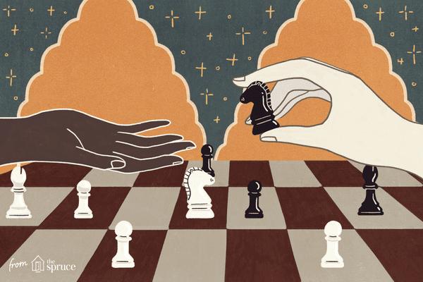 hand handing over chess piece
