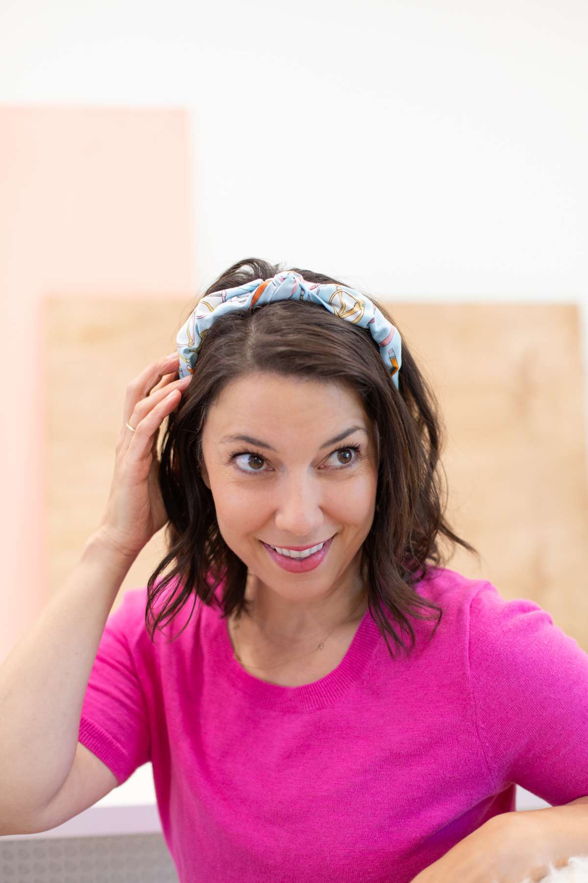 Woman wearing a DIY scarf headband