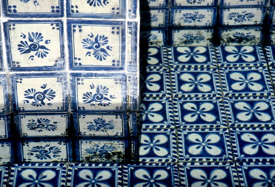 Detail of the traditional Talavera mosaic used to decorate a public fountain in a street of Puebla, Mexico