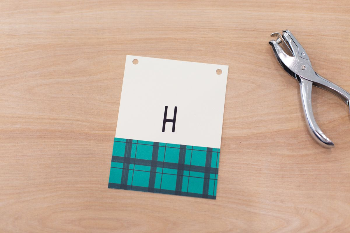 Letter and hole punch flags for a DIY birthday banner