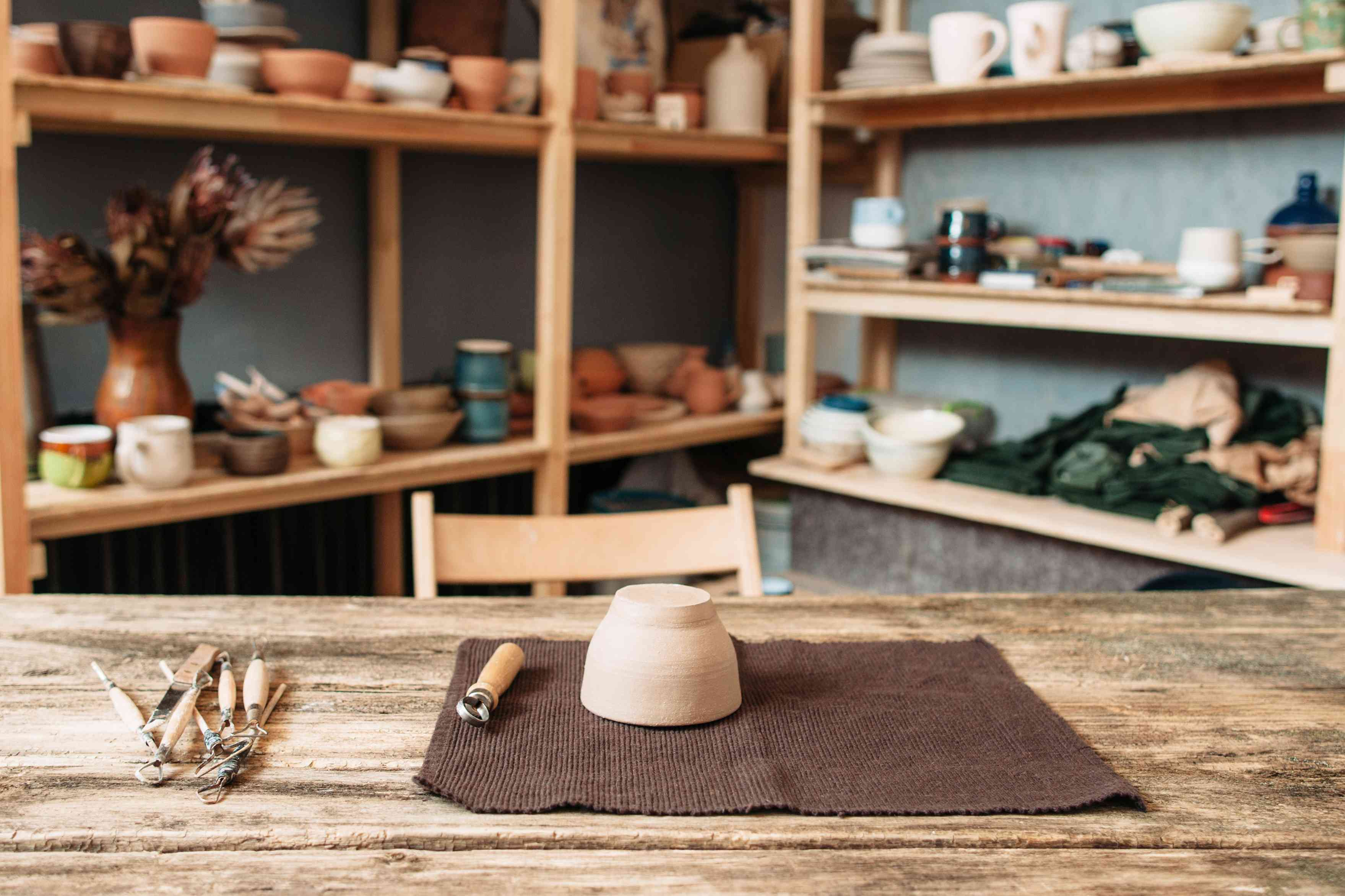 Potter workplace with necessary tools at studio