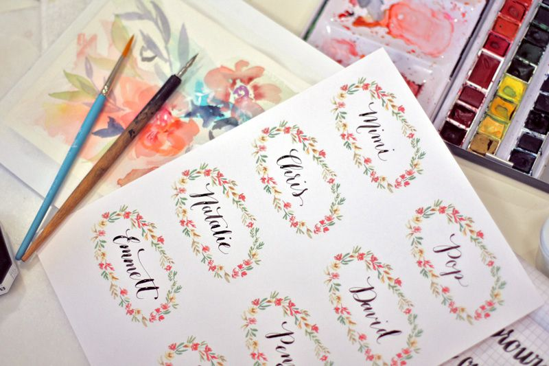 A sheet of Thanksgiving place cards by paints and paintbrushes