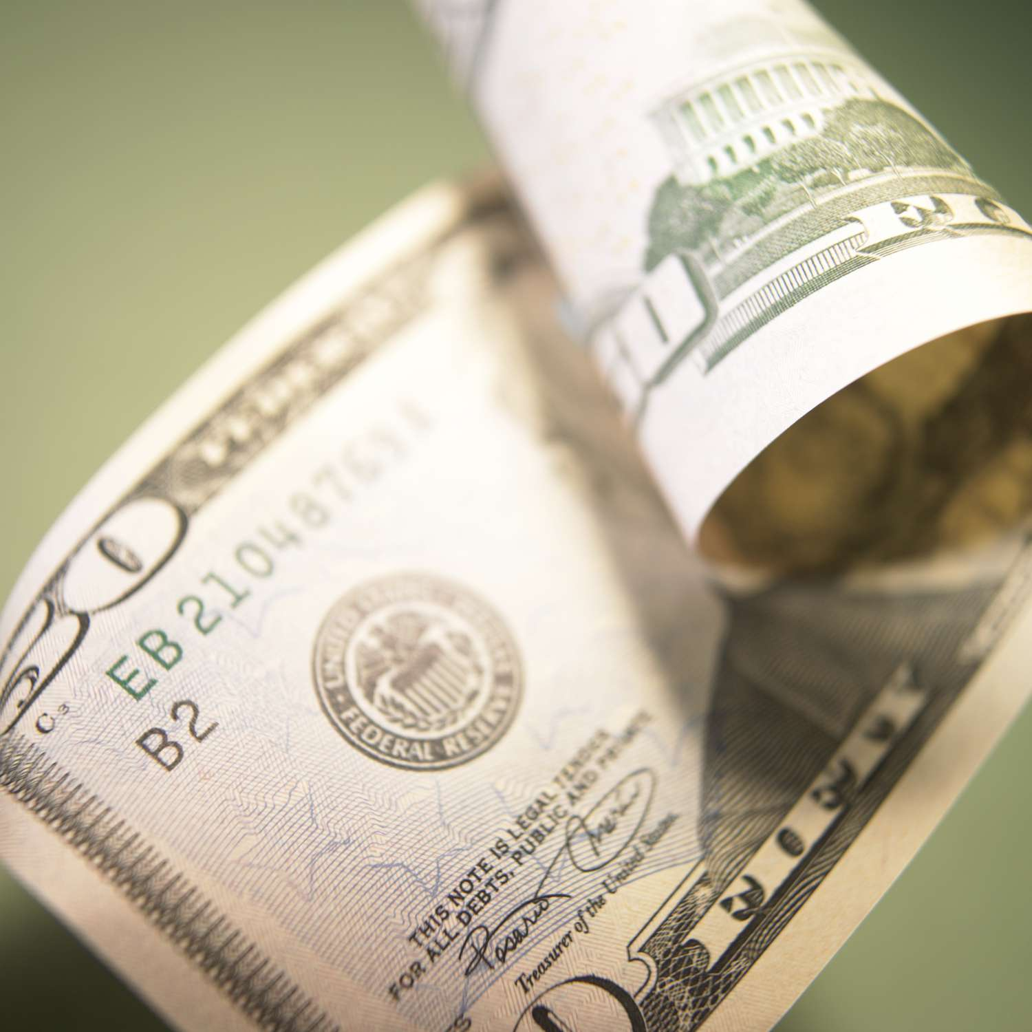 US Currency: Curled fifty dollar bill, close-up