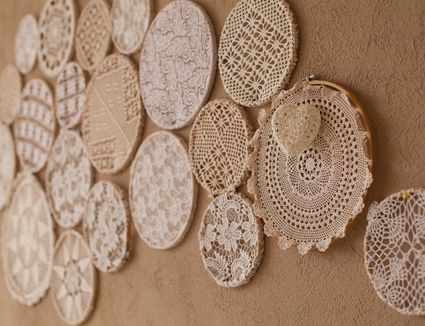 Lace doilies hanging on wall