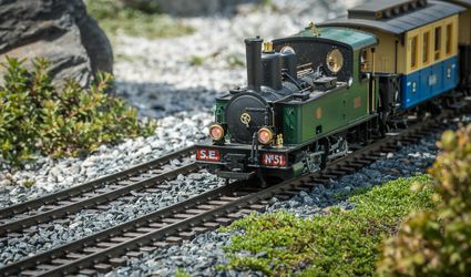 Railway modelling train outdoors on a sunny day