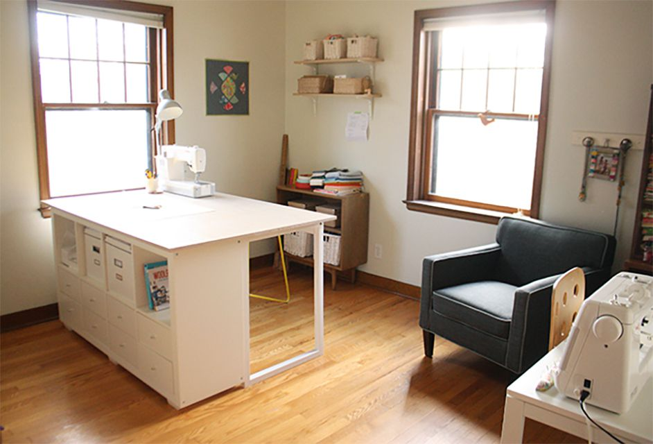 A sewing room with a large sewing table