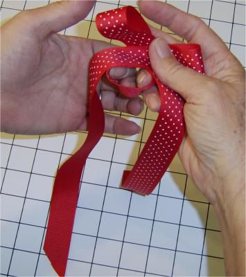 Folding ribbon loops over each other