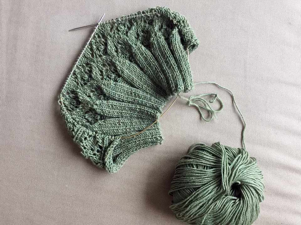 knitting project in green color