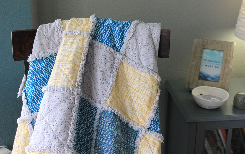 A rag quilt draped on a chair