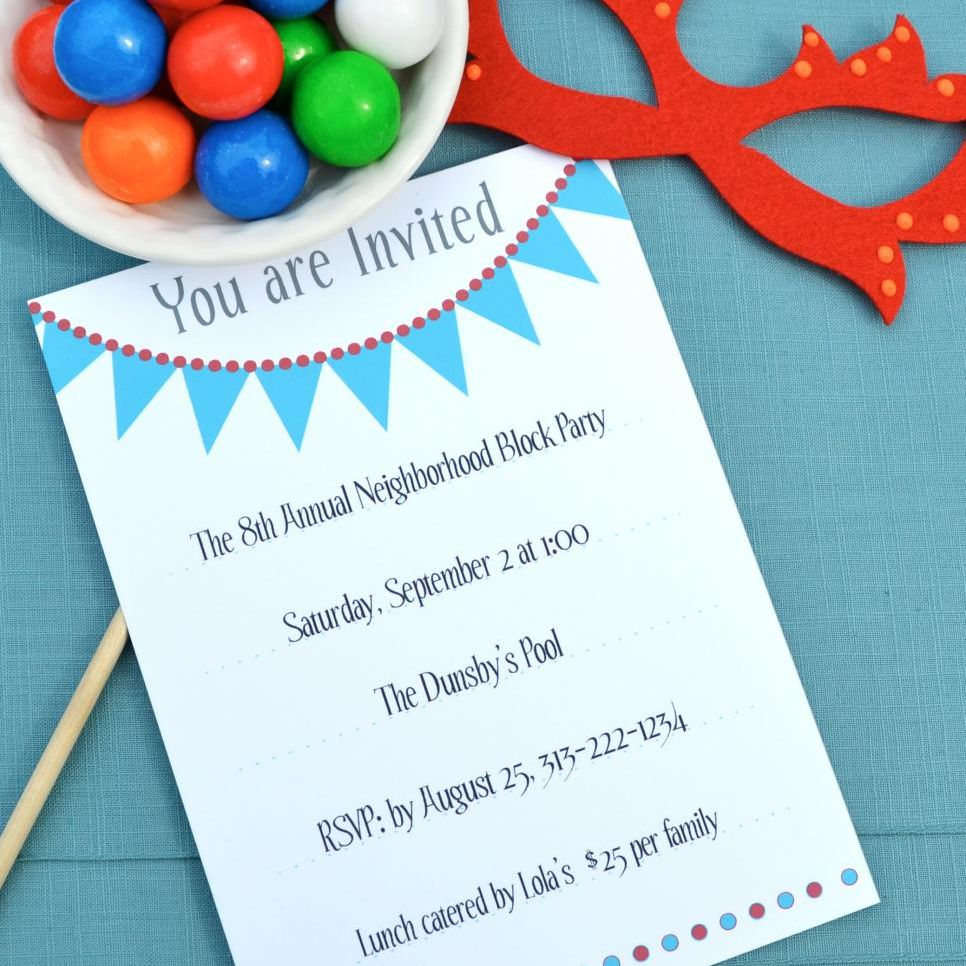 A birthday party invitations on a table with candy and a mask