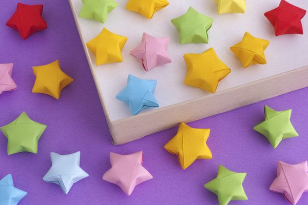 Origami lucky stars spread out over surface