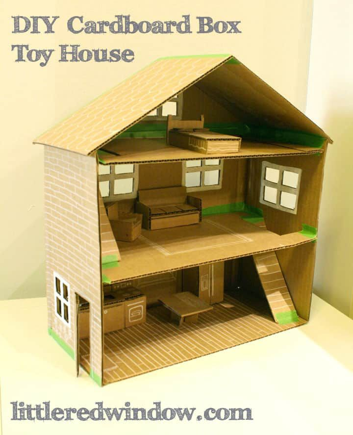 A doll house made out of a cardboard box