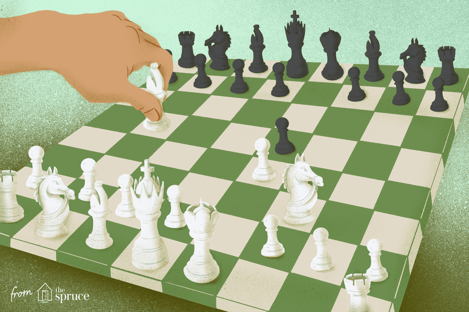 A hand moving a chess piece