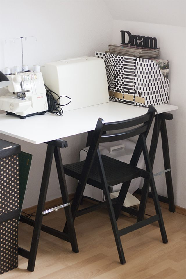 A black and white sewing desk