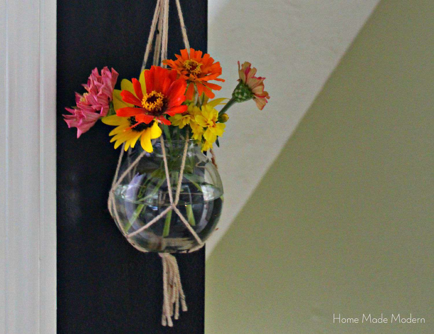 macrame hanging plant holder with flowers