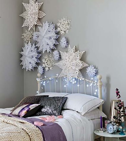 paper snowflakes on a bedroom wall